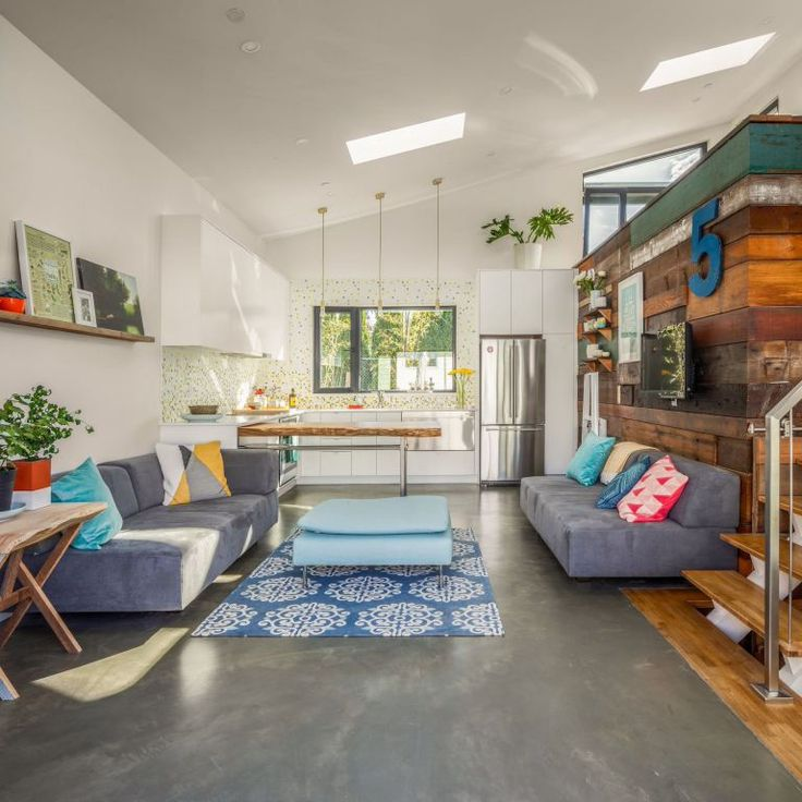 The owner's personality shines through in this Vancouver laneway house. It has one bedroom and an office loft in 760 sq ft. | www.facebook.com/SmallHouseBliss