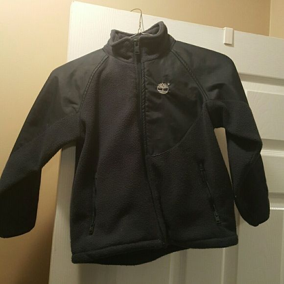 Boys Fleece Timberland Jacket Size 5 Used Boys Timberland Jacket. Fleece material. Navy blue. No rips, holes or stains. Pet and smoke free home. Size 5. My sons name on the label Timberland Jackets & Coats