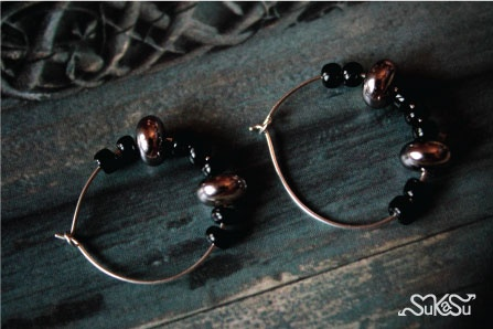 The black and silver ring... what more adds beauty..