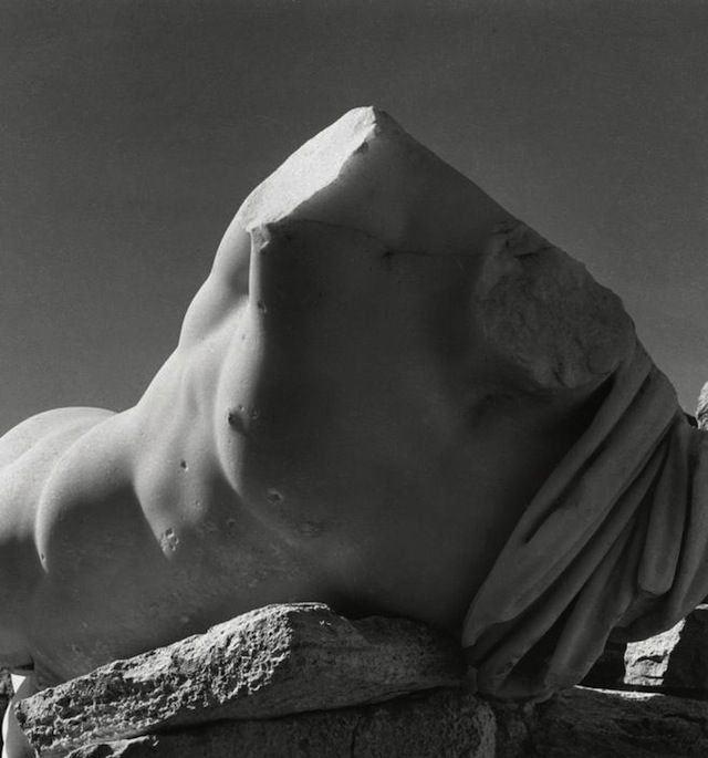 "Athens, Greece, 1937. ""Spirit of Lycabettus."" Photographs of mortals, stones and spirits by Herbert List. Haunting, mystical, epic, and sometimes funny. Above, Lycabettus. Above, the shadows of Poseidon's Temple. Above, Santorini Island, 1937. ""The captive fish in its bowl and the open sea symbolize man who, being tied to earth, can never quite break free...  Read more »"