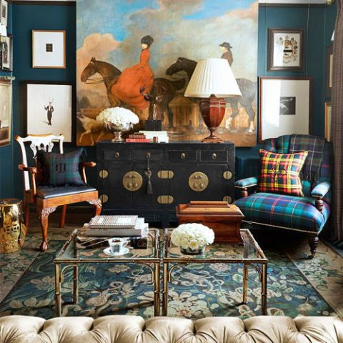 A lacquered chest from Tansu Design anchors one end of the living room. The large painting above it is a vintage theater backdrop. Lee Jofa Draycott armchair in Ralph Lauren Home's Wexford Plaid. Silver faux-bamboo cocktail tables from the 1920s. Rug, Stark.