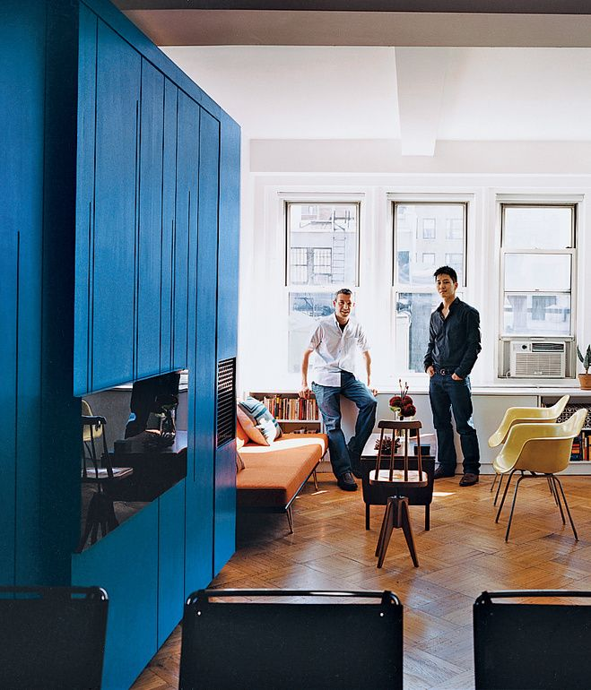 A single transformer like cabinet does all the work in this 450 sq ft apt.  Eric Schneider and Michael Chen take in the space-efficient renovation.  Photo by Raimund Koch.