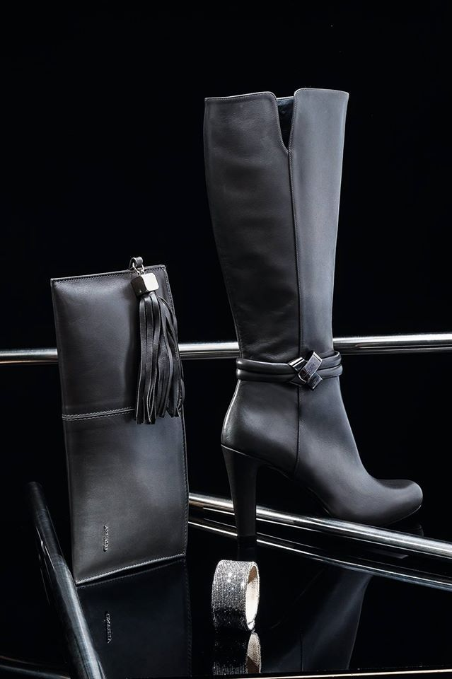 Albano realizes a shoes for every event. Boots and pochette black calf.