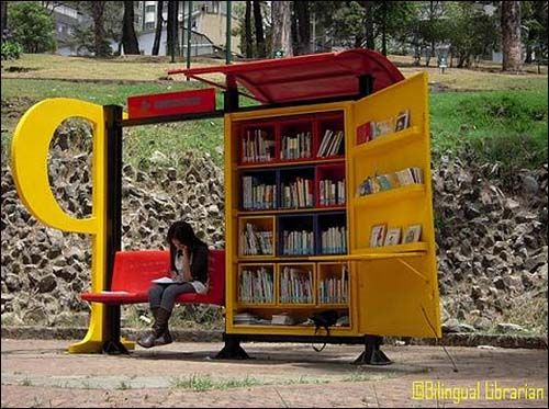 Mini Public Library in Bogota, Colombia - borrow a book, leave a book.  Photo -  Paradero Para Libros Para Parques image via BilingualLibrarian.com