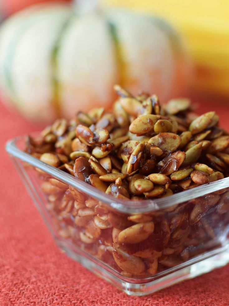 Maple Spiced Pumpkin Seeds - a simple, flavorful paleo and dairy-free recipe for using up leftover pumpkin seeds! Eat them straight, top a salad, or mix with dairy-free yogurt.