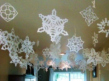 Hanging snowflakes from ceiling
