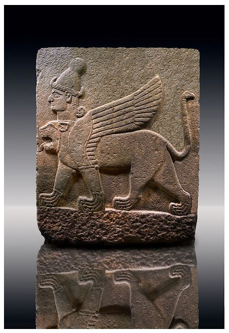 Picture & image of a Neo-Hittite orthostat describing the legend of Gilgamesh from Karkamis - Turkey. A three headed Sphinx which is a winged lion with a human heas and a bird of prey's head on the end of its tail. | © Paul E Williams 2013
