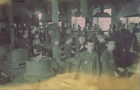 "Jewish children working in a locksmith's workshop in the Lodz ghetto.  Original German caption: ""Getto-Litzmannstadt, ""Schlosserei"" (locksmith), #15."