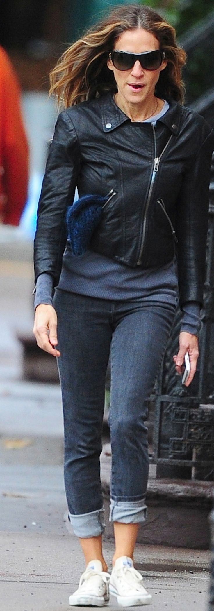 Finish jeans and a leather jacket with white Converse, a la Sarah Jessica Parker