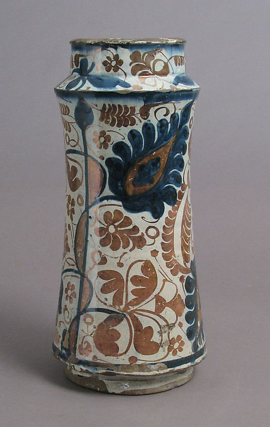 Pharmacy Jar  Date: second half 15th century Geography: Made in probably Manises, Valencia, Spain Culture: Spanish Medium: Tin-glazed earthenware Dimensions: Overall: 12 1/16 x 5 5/8 in. (30.6 x 14.3 cm)