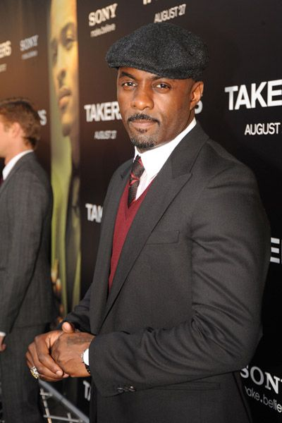 idris elba photos with his shirt off | Idris Elba kept it dapper with his black suit, maroon vest and newsboy ...