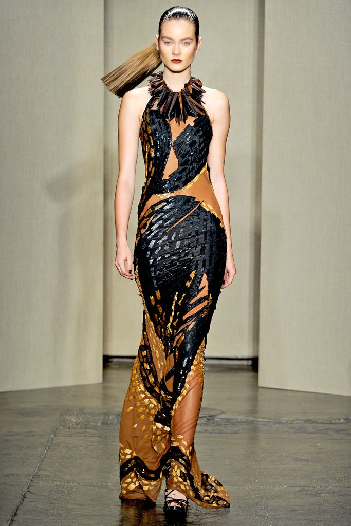 Donna Karan Spring 2012: Donna Karen often incorporates ethnic aesthetics in her collections like this gown that channels a sporty gown inspired by the work of the Haitian artist Philippe Dodar.