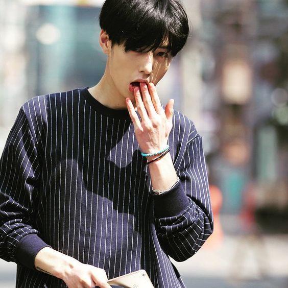 Boy in plum coloured shirt