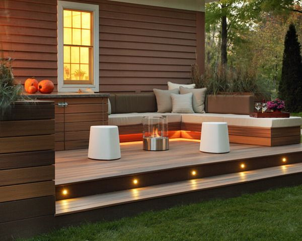 wooden backyard patio deck ideas with lighting fixtures and portable fireplace