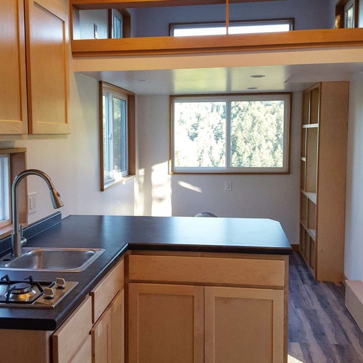 Modern Green Built Tiny Home for sale. This 264SF Tiny Home on Wheels is a wonderful, bright, efficient space with living room, kitchen, bath and sleeping loft. Full of modern amenities and great space efficiency this makes a great backyard cottage, rental unit or off grid cabin.  Built on an Iron Eagle PAD trailer the…