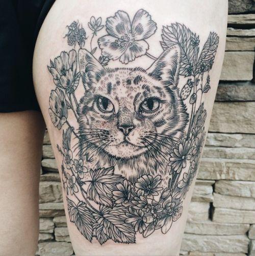 Tattoo: cat portrait with lewisia, clarkia amoena, thimbleberry, and alpine strawberry. By Pony Reinhardt in Portland, OR.