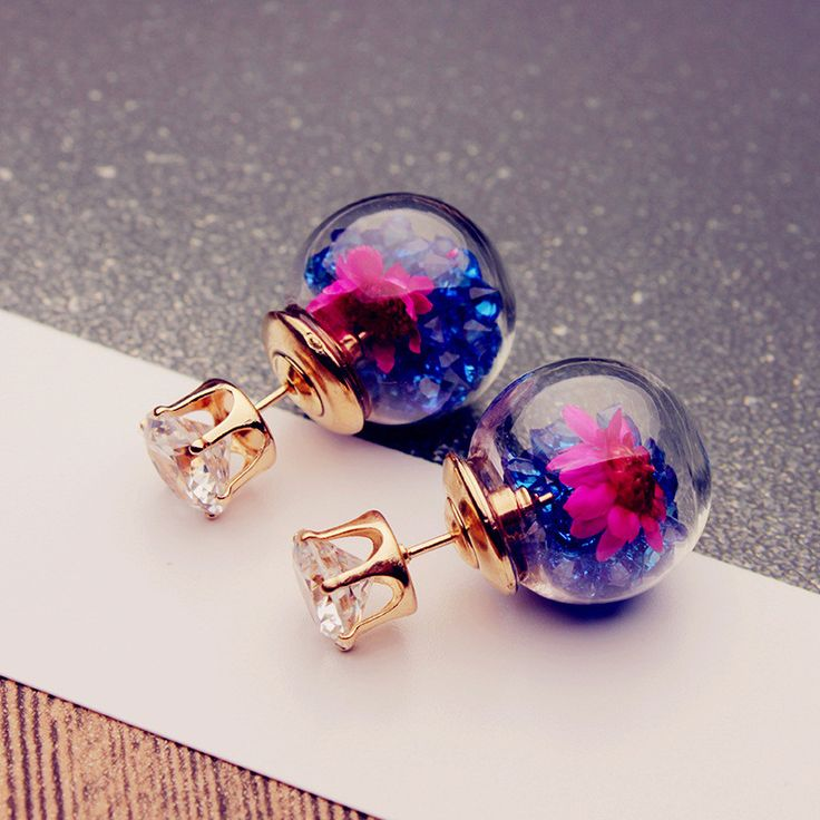 US$3.99~4.99 + Free shipping. Colorful Crystal Glass Ball Flower Round Earrings. Main Color: Pink, Light Blue, Purple, Rose Red, White, Blue. Nickel-free Plated or 925 Sterling Silver Needle.