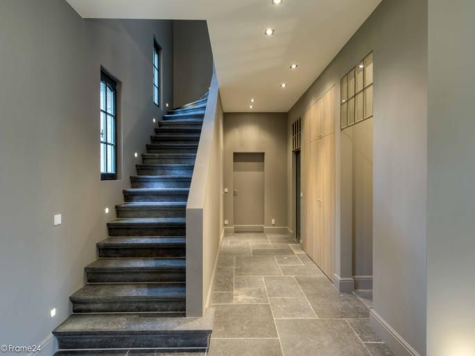 soft limestone (or travertine?) floor and pretty neutral wall paint and lighting - Staircase Frank Missotten