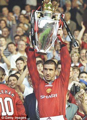 Eric Cantona lifts the 1997 Premier League trophy