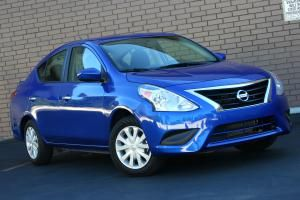 2015 Nissan Versa Sedan review: 2015 Nissan Versa SV -- Chrome grille now standard across the board