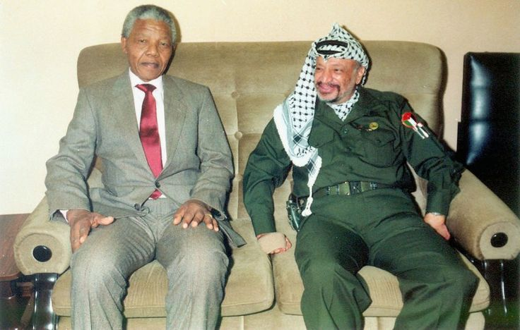 In this undated file photo Palestinian leader Yasser Arafat is pictured meeting with Nelson Mandela the former leader of South Africa. Medics announced on October 31