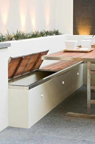 Outdoor storage bin/bench. Love the lighting accents as well.