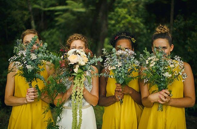 With yellow bridesmaid dresses and green bouquets the brides white dress and sunflower bouquet would pop well