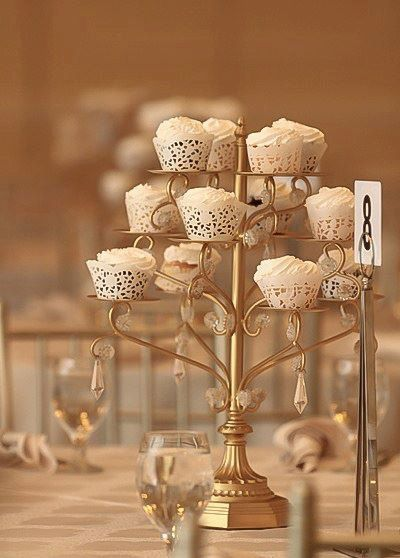 Hey, I found this really awesome Etsy listing at https://www.etsy.com/listing/184410023/gold-cupcake-candelabra-cupcakes-stand