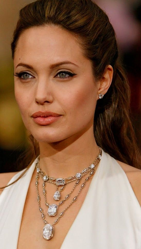 Angelina Jolie in H. Stern at the 2004 Oscars:   More proof that Angelina has an unerring eye for jewels. This necklace by H Stern is serious stuff: $10 million in important diamonds in a graceful waterfall that emphasizes the plunging neckline of her gown.