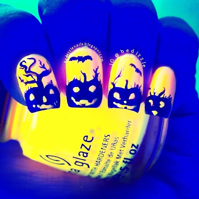 Glow in the dark Halloween pumpkin nails?! this is soooo cool! So wish I could do this for Halloween! <3