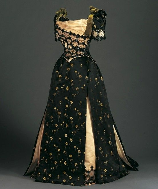 Reception Dress (Bodice and Skirt), c.1890 Brocaded silk satin, cotton net, and beads By Miss Foley, Philadelphia, American