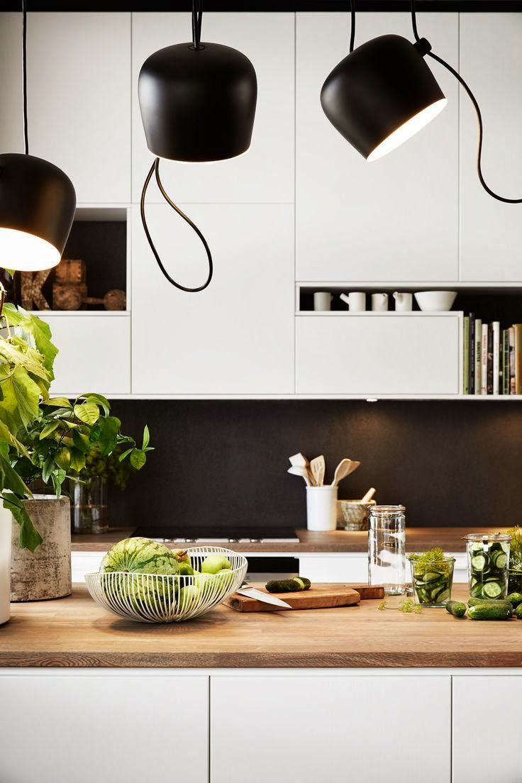 White Kitchen. Light fixtures: Aim by Flos