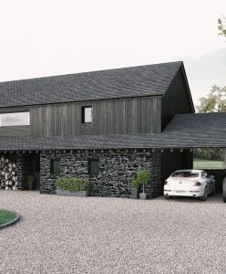 A barn style home, featuring natural stone and finished with charred larch cladding