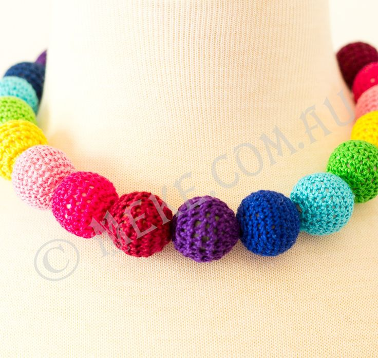 : : Rainbow Pom Pom Necklace : :  Your special little Rainbow Brite will have a great time shaking her pom poms in this adorable handcrafted necklace featuring a rainbow of purple, dark blue, light blue, green, yellow, light pink, dark pink and maroon wool covered round beads. Too cute!!!   See my Etsy shop for more info or to purchase: https://www.etsy.com/au/listing/153787106/rainbow-pom-pom-childrens-necklace?ref=shop_home_active  Handmade with love and care by Marianne ❤