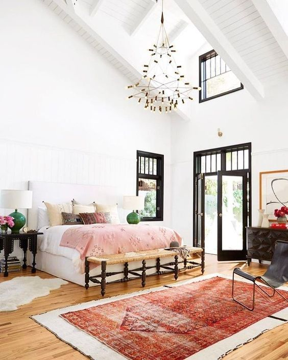Think Big In The Bedroom! Light, Bright And Boho Romance. High Ceiling,  Black Joinery, Large Rug, Bench At End Of Bed