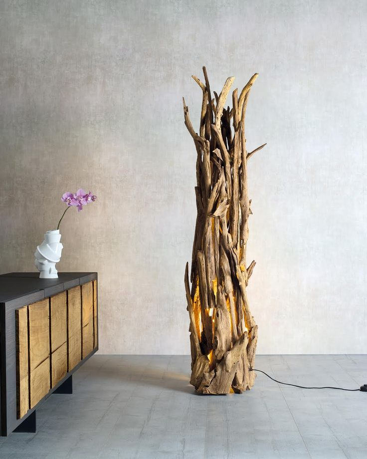 UCIGNOLO | Intertwined branches of ancient wood compose the structure of the Lucignolo lamp. The lamp holder in the base confirms the uniqueness of the decor element in the perfect style of Nature Design. #NatureDesign #madeinitaly