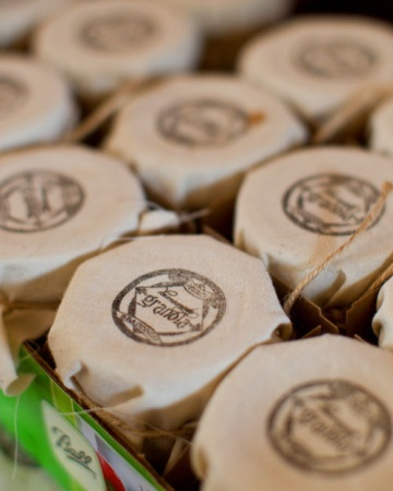 "DIY Wedding Favors - Homemade Granola"" with a custom stamp by theRUBBERpress. Linen was then stamped and secured around the tops of the jars with a wrapping of twine."