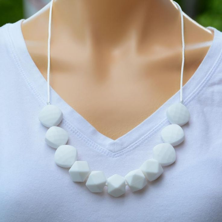 Our Twist Range. A white teething necklace for you to wear and your baby to chew on.