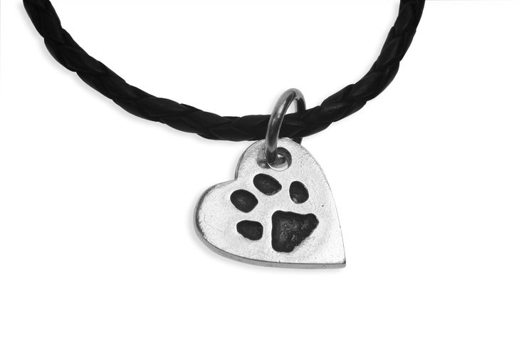 Paw print heart pendant on leather   www.silverpetprints.com