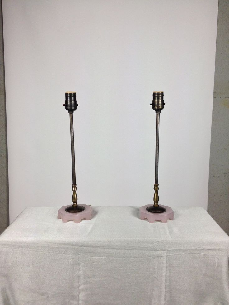 Delicate American-made bedside table lamps in a brass candelabra style with pink glass feet typical in shape to that made by Housex although there is no maker's mark.  These pieces are early 20th century, and would compliment any bedroom or fine living room.    10cm diameter  38.5 cm H