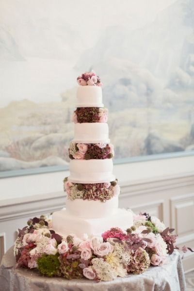 Tall and narrow wedding cake: http://www.stylemepretty.com/destination-weddings/2015/02/25/glamorous-ballroom-wedding-in-scotland/ | Photography: Craig & Eva Sanders - http://www.craigsandersphotography.co.uk/