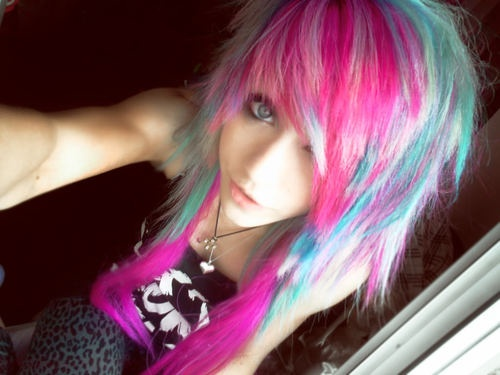 "Bright colored hair (rainbow), piercings and bold eye make-up.  Emo girl look for the Anime Emo Punk Tech Movement of 2054 in book series, ""The Biodome Chronicles""  by Jesikah Sundin (see board for ""Legacy"", ""Elements"" and ""Gamemaster"")"