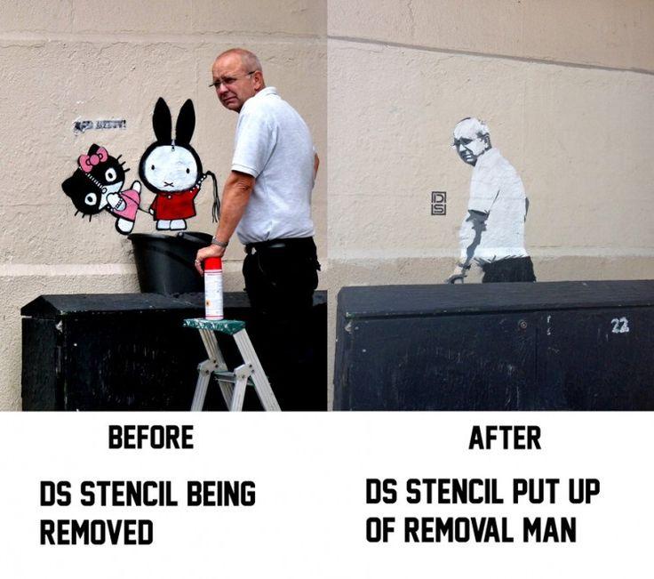 """L'uomo che rimuove il graffito da un muro di Essex Road, a Londra, diventa a sua volta un murales su quella stessa parete. E' questa la """"vendetta"""" del 28enne street artist DS che ha visto ricoprire il suo murales chiamato """"Bad Kitty"""" poche ore dopo averlo ultimato."""