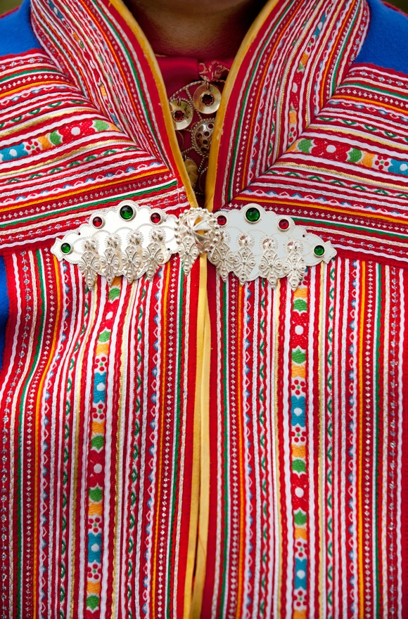 Sami man's costume features yards and yards of ribbons.