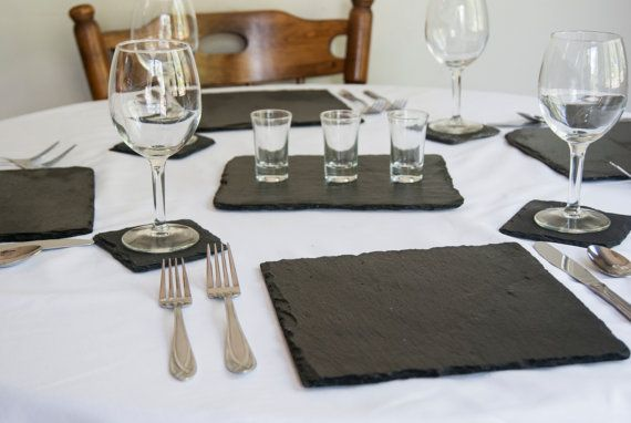 Serve your guests on a little piece of history. These natural slate plates were once roofing tiles, removed from an Ohio barn in the 1970s. The slates