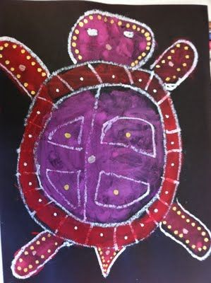 Turtle guided drawing using white oil pastels and then painted with tempera paints.  The last step uses a metallic paint pen