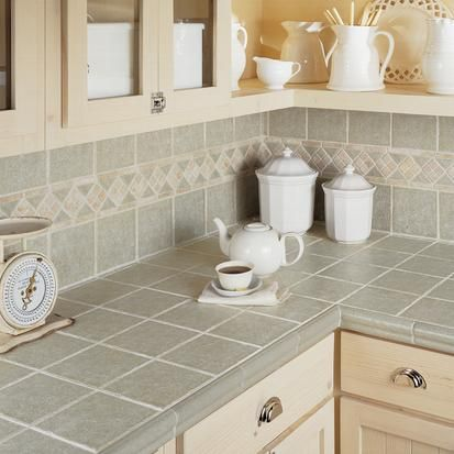I don't like the decorative band, but I do like the tile work.  Straight lines, rounded edging...looks great.  This is how I'd imagine the corner looks.  ..lots of information on caring for tile countertops at this site...choices in tile, too.