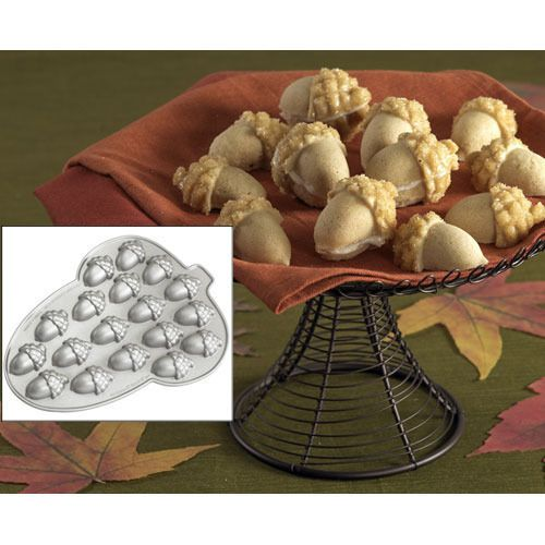 This acorn pan has arrived just in time for you to store up some treats this fall. Acorn-shaped pan is 14 long x 11-3/4 wide with 18 mini acorn shaped cavities. Each cavity is 2-1/2 x 1-3/4 x 1 deep with a 2-cup total liquid capacity. Heavy cast aluminum ensures even baking and elegant details. Premium nonstick surfaces offer easy release and clean-up. Nordic Ware®. Limited lifetime warranty. Recipe included on packaging.