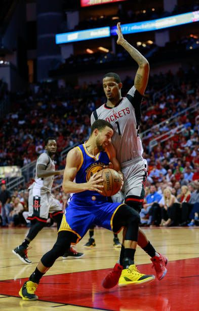 Stephen Curry of the Golden State Warriors drives on Trevor Ariza of the Houston Rockets at Toyota Center on March 28 2017 in Houston Texas NOTE TO...
