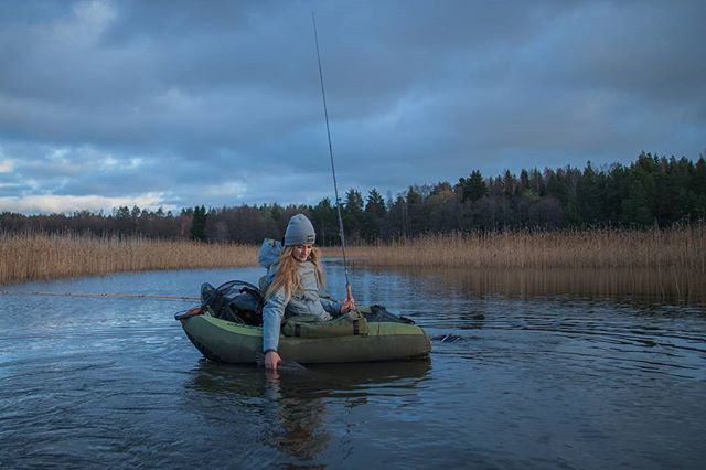 Fishing photography, women that fish and hike. Fishing in Finland.